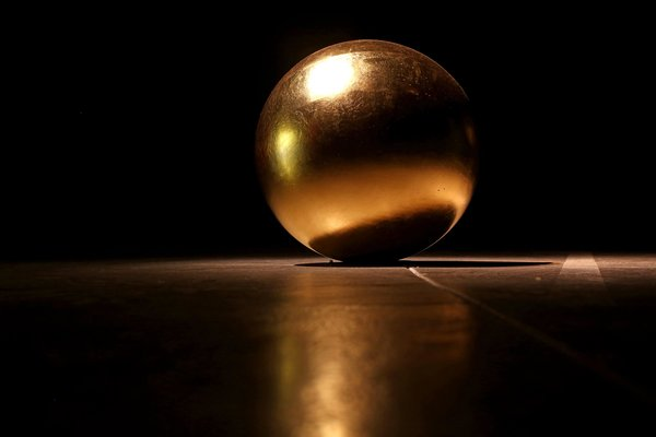 Gilt wooden sphere by James Lee Byars