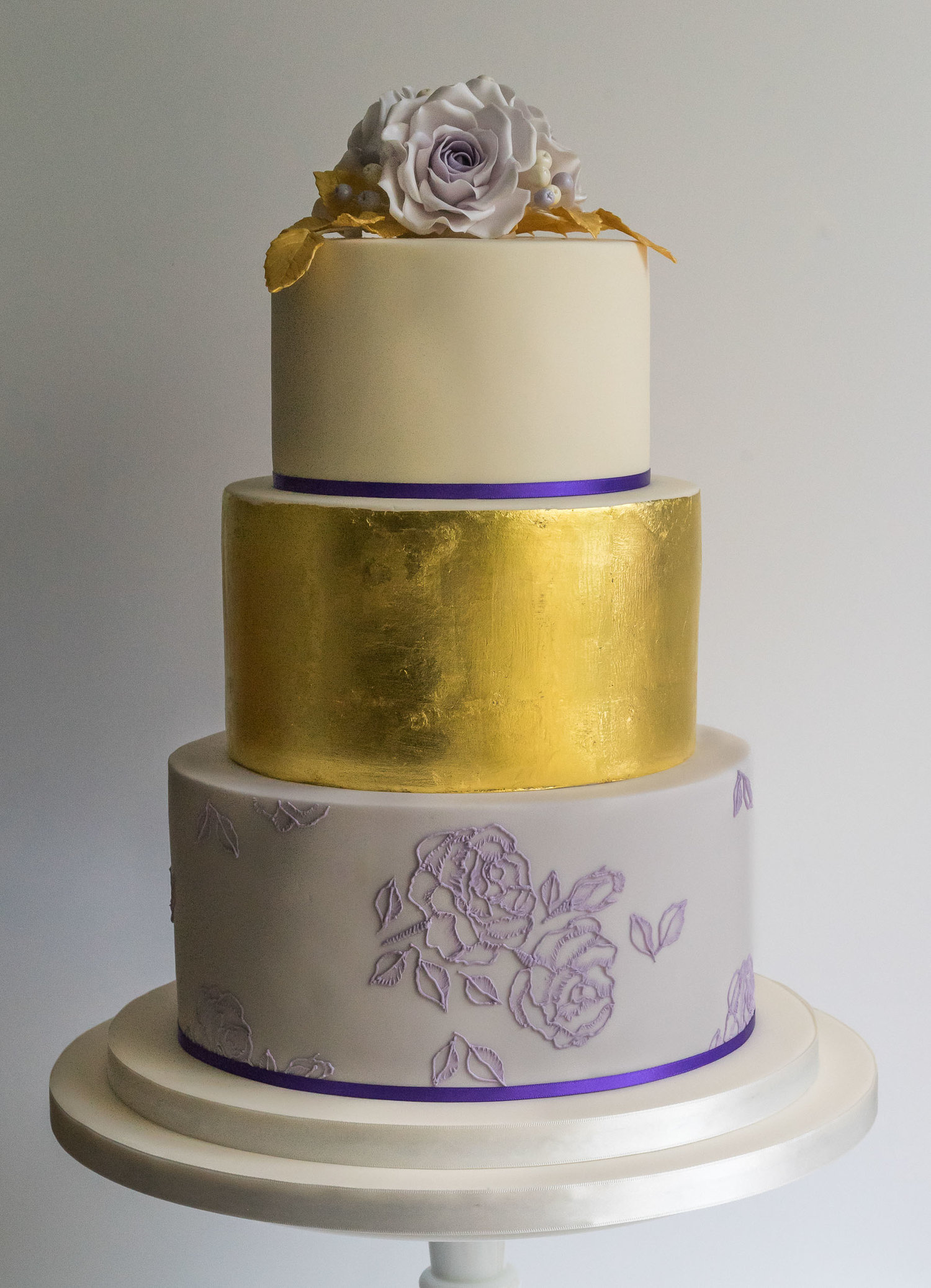 Gold wedding cake by Cost Wold cake Kitchen.