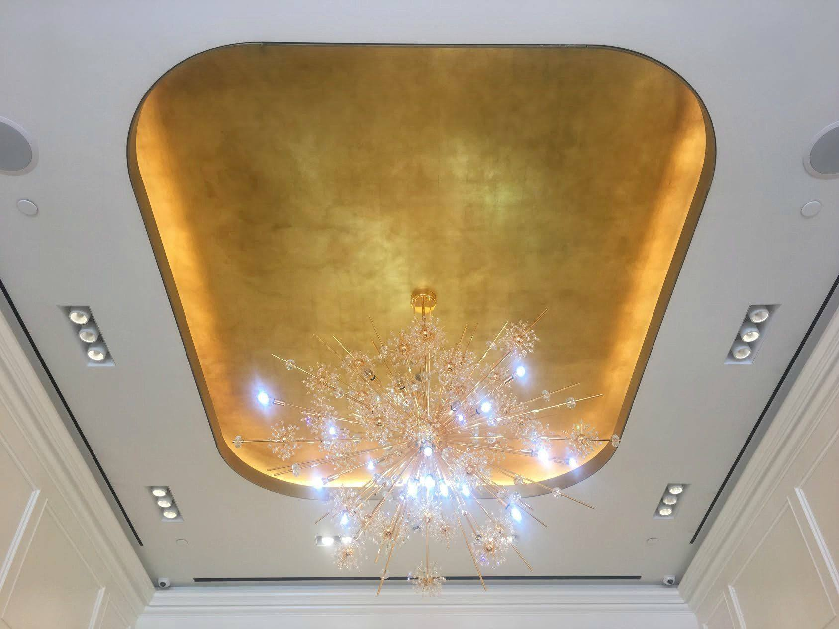 This impressive ceiling is beautifully decorated with goldleaf