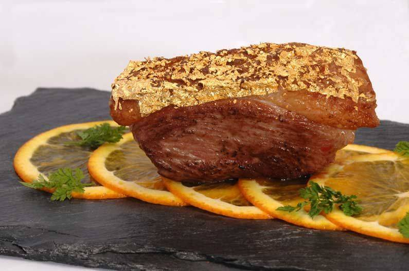 Are you looking for a delicious menu to present to your guests ? This is duck with an orange flavor covered by an edible gold leaf.