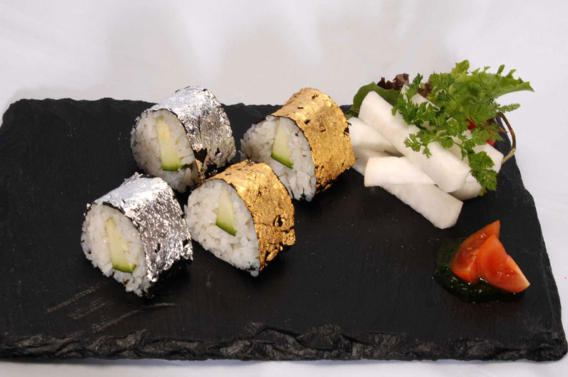 sushi decorated with edible gold and silver