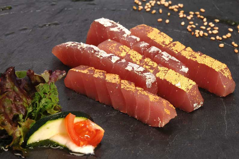 Tuna sashimi with edible gold and edible silver