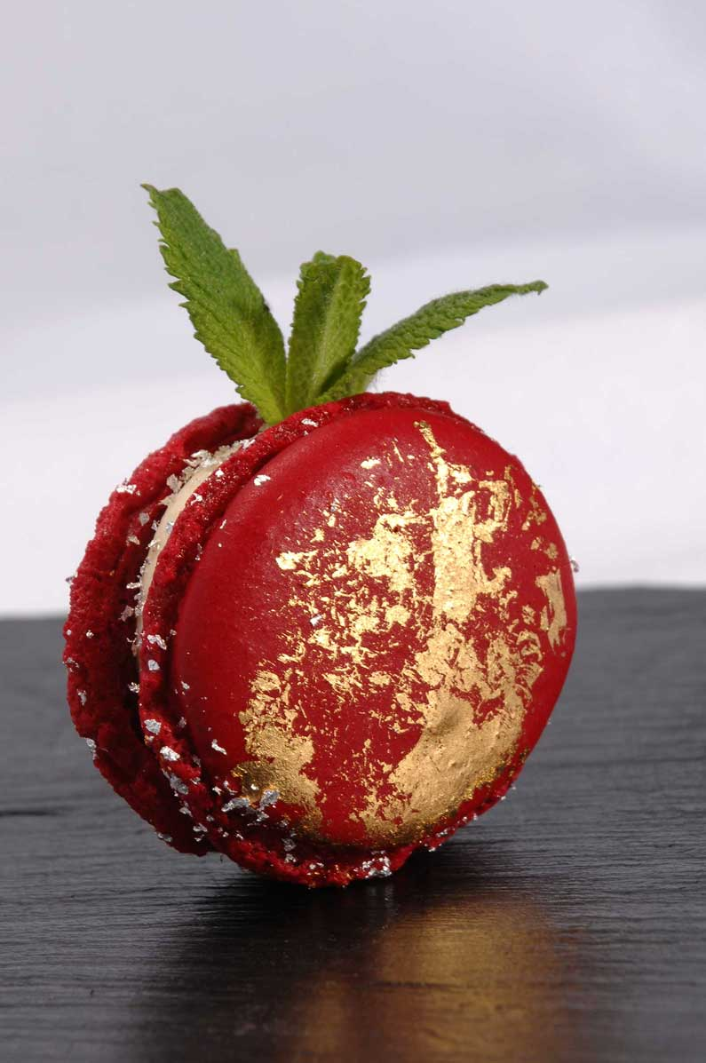 Berry Macaron with edible silver flakes and gold leaf